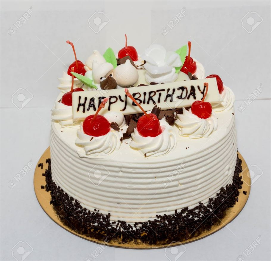 Black forest cake  with the words happy birthday.